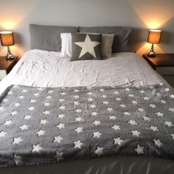 Light grey super soft throw...